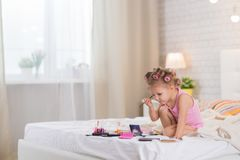 Little girl in the bedroom stock photography