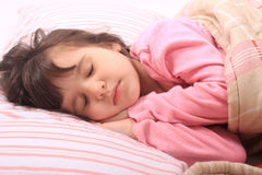 Little girl bedtime Stock Images