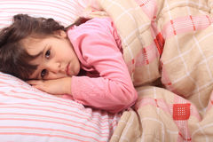 Little girl bedtime Stock Photos