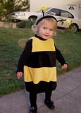 Little girl bee costumes royalty free stock photos