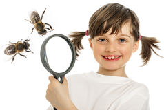 Little girl and bee Stock Images