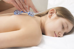 Little girl is beeing treated with a massage stock image