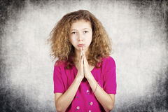 Little girl begging for forgiveness Stock Photography