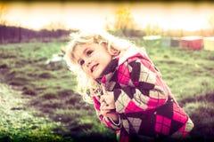 Little girl begging Stock Images