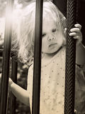 Little girl behind bars Royalty Free Stock Photos