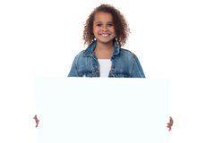 Little girl behind blank whiteboard Stock Photo
