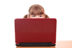 Little girl behind laptop Royalty Free Stock Photos