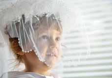 A little girl behind veil Royalty Free Stock Photo