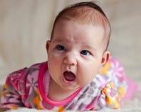 Little girl on  beige blanket Royalty Free Stock Photo
