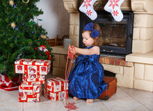 Little girl being happy about christmas present. Royalty Free Stock Photos