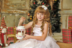 Little girl being happy about christmas present Royalty Free Stock Photo