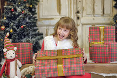 Little girl being happy about christmas present Royalty Free Stock Photos