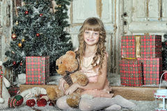 Little girl being happy about christmas present Royalty Free Stock Photography