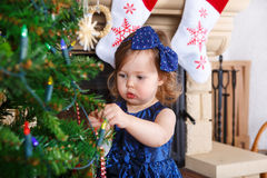 Little girl being happy about christmas tree and lights Royalty Free Stock Image