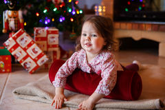 Little girl being happy about christmas tree and lights Stock Photography