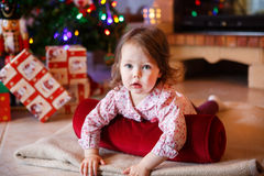 Little girl being happy about christmas tree and lights Royalty Free Stock Images