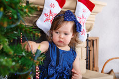 Little girl being happy about christmas tree and lights Stock Image