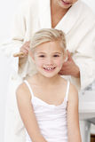 Little girl being pretty in bathroom Royalty Free Stock Images