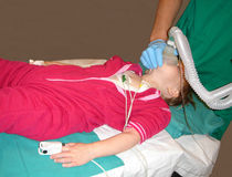 Little girl being sedated Stock Images
