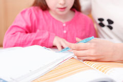 Little girl being taught writing and reading Royalty Free Stock Photos