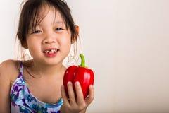 Little Girl with Bell Pepper / Little Girl Holding Bell Pepper Studio Isolated Stock Photo