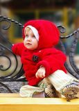 Little girl on a bench Stock Photo
