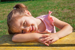 Little girl on bench Royalty Free Stock Images