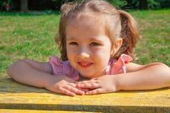 Little girl on bench stock photos
