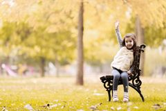 Little girl at the bench Royalty Free Stock Photos