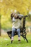 Little girl at the bench Stock Images