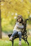 Little girl at the bench Royalty Free Stock Photo