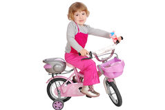 Little girl with bicycle Stock Photos