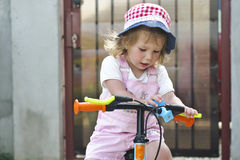 Little girl on bicycle Stock Photo