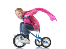 Little girl on bicycle. White background Royalty Free Stock Photos