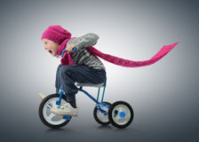 Little Girl on bicycle. On dark background Stock Photography