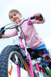 Little girl on a bicycle.  Royalty Free Stock Photo