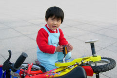 little girl and bicycle Stock Photography