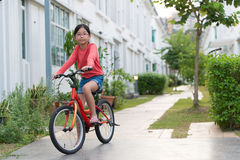 Little girl on bicycle Royalty Free Stock Photos