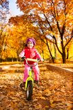 Little girl on a bicycle Stock Images