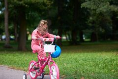Little girl with bicycle Royalty Free Stock Photography