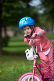 Little girl with bicycle Royalty Free Stock Image