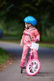 Little girl with bicycle Royalty Free Stock Photos