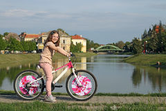 Little girl with bicycle Royalty Free Stock Images