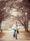 Little girl on a bicycle Royalty Free Stock Images