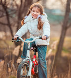 Little girl on a bicycle Stock Photography