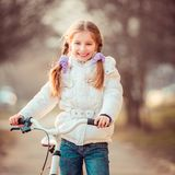 Little girl on a bicycle Stock Photos