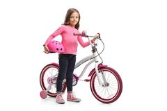 Little girl with a bicycle and a helmet. Full length portrait of a little girl with a bicycle and a helmet isolated on white background Royalty Free Stock Image