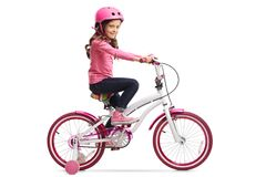 Little girl with a bicycle. Isolated on white background Stock Photos