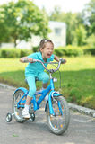 Little girl with bicycle Stock Photography