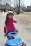 Little girl on bicycle. In the park Stock Photo